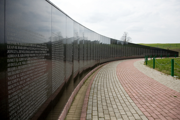 The KLA memorial, similar to the Vietnam War memorial in Washington D.C., stands on the road from Drenas to Skenderaj.