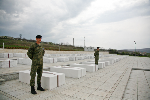 Soldiers guard graves at the Prekaz memorial. Though politicians occasionally try to politicize the site of the Jashari family massacre, surviving relatives serve as reminders that it is a sacred ground.